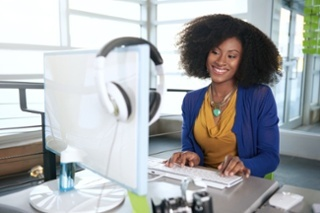 Woman at Desk having Frictionless Workforce Experience