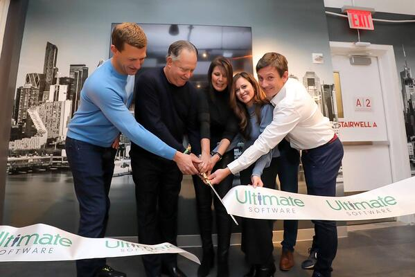 Executive leadership during the NYC office ribbon cutting