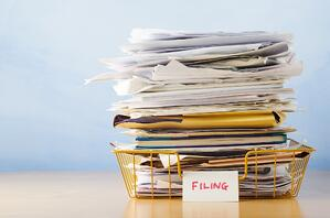 stack of paper employee files